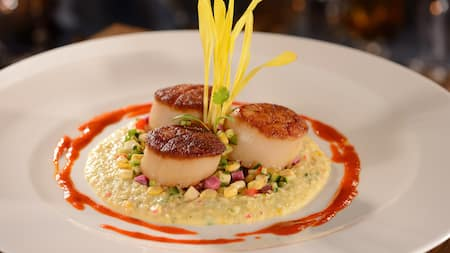A seafood dish with sauce on a plate