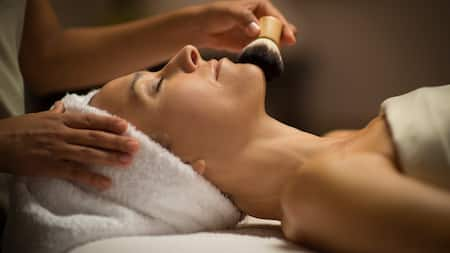 A woman relaxes while receiving a spa service