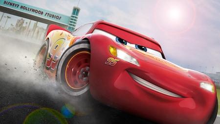 Lightning McQueen speeds down a racetrack at Disney's Hollywood Studios