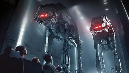 People in a transport vehicle inside a hanger bay look up at 2 towering AT-AT walkers