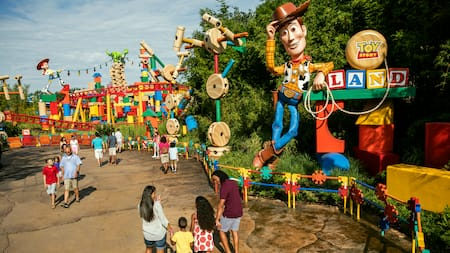 People stand near the entrance of Toy Story Land