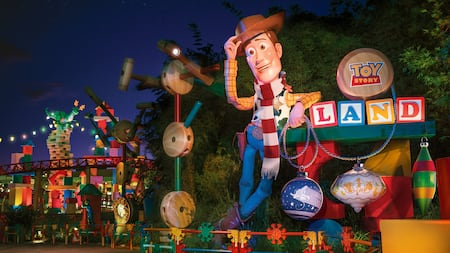 The entrance to Toy Story Land reveals a larger than lifesize figure of Sheriff Woody
