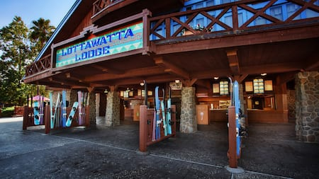 The outside of Lottawatta Lodge with skis and snowboards