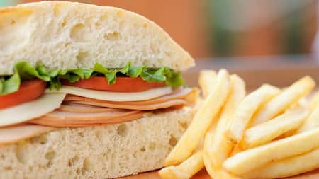 A sandwich with a side of fries