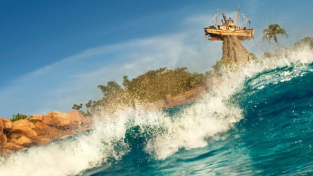 A wave crashing down with a boat teetering on a rock in the distance
