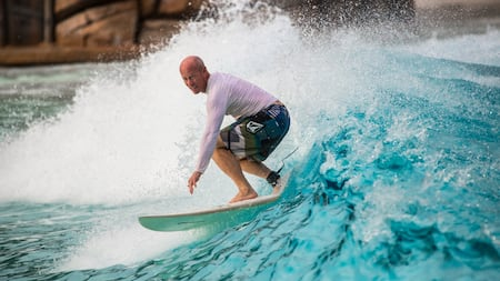 A man surfs on a wave