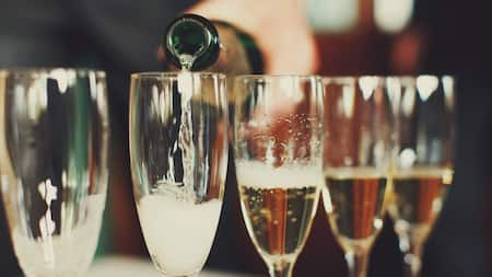 Champagne poured into champagne glasses