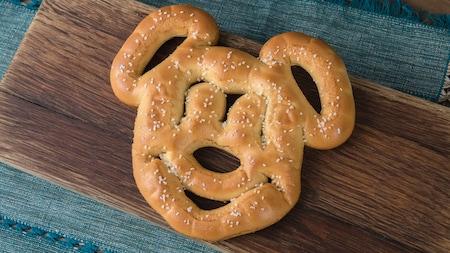 A mickey shaped soft hot pretzel.