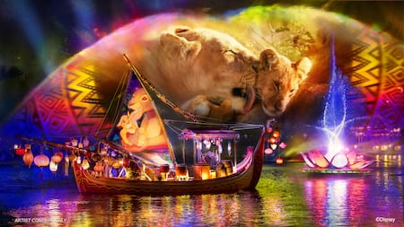A boat adorned with lanterns sails across the water under a projection of a lioness and her cub