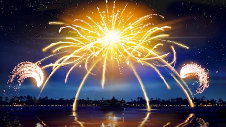 Fireworks burst over a lake at Walt Disney World Resort, reflecting in its water