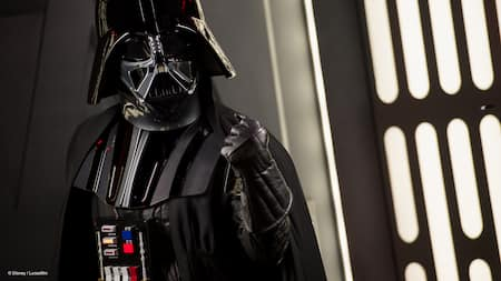 Darth Vader gives a menacing stare while clenching his fist