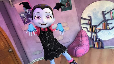 Vampirina, a vampire ballerina, dances in her room