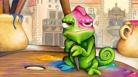 An illustration of a frog on an art palette, looking grumpy because paint has dripped on him