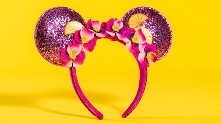 A sparkly Minnie Ears hair clip featuring flowers
