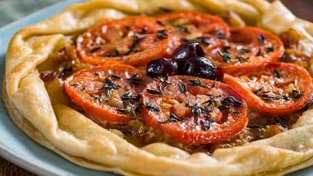 A tomato tart with a flaky crust