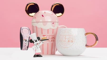 A Minnie Mouse figurine with a Magic Band and mugs themed after the 2019 Food & Wine Festival