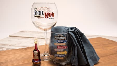 A wine glass and stopper set with Food and Wine Festival messaging