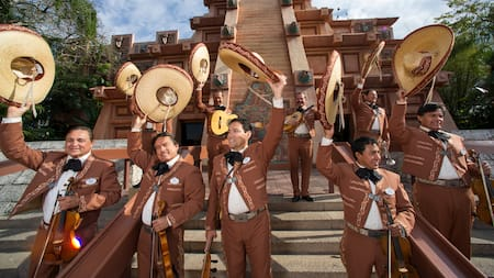 Mariachi Cobre performers greet guests in front of Epcot's Mexico Pavillion