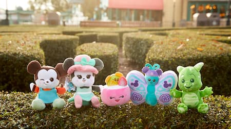 Disney Wishables Merchandise products line sits on grass hedge