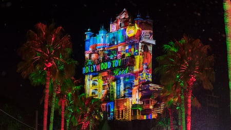 Festive holiday projections on The Hollywood Holiday Tower Hotel during the Christmas season