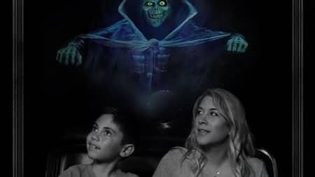 A boy, his mom and 3 ghosts are in a photo that reads The Haunted Mansion