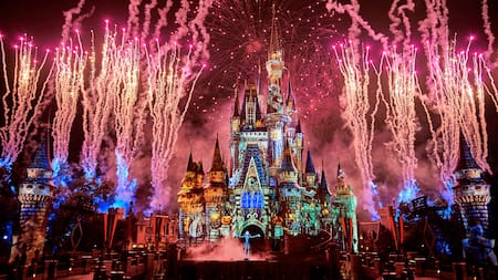Jack Skellington stands on stage in front of Cinderella Castle as fireworks burst around him