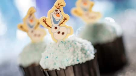Frosted cupcake treats with a figure of Olaf the snowman on each