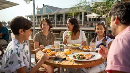 Family enjoys a meal together at Disney Springs
