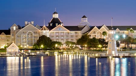 Disney's Yacht Club Resort on Cresent Lake at dusk