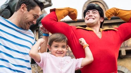 A young boy flexes next to Gaston