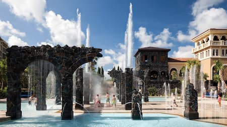 Children playing in the splash zone at Four Seasons Resort Orlando at Walt Disney World Resort