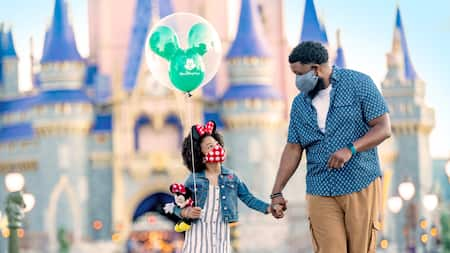 Father and daughter in front of Cinderella's Castle