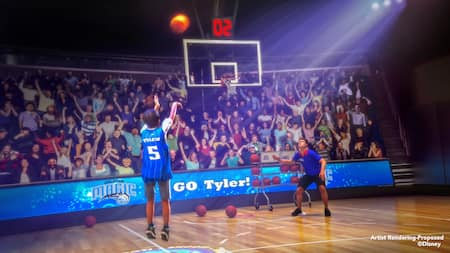 A crowd cheers as a boy shoots a basket at The NBA Experience in Disney Springs