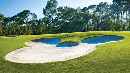 A bunker in the shape of Mickey Mouse on the Magnolia Golf Course