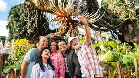 A group of people take a selfie at Pandora World of Avatar