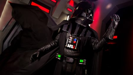 Darth Vader strikes a fearsome pose, his cape flowing in the breeze