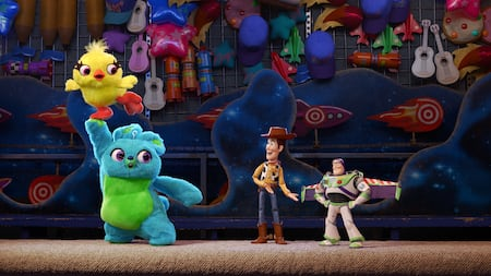 Woody and Buzz talk to Ducky and Bunny amid other toys in a store in Toy Story 4