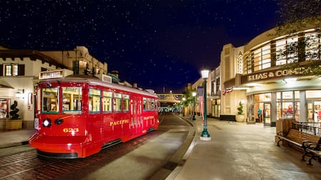 A trolley car on Buena Vista Street at night