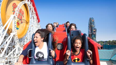 Excited Guests ride Incredicoaster