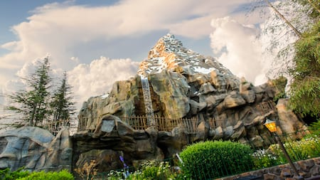 The icy mountain of Matterhorn Bobsleds, featuring a waterfall and a rickety fence along its track