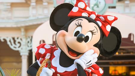 Minnie Mouse carries a basket and strikes a cute pose