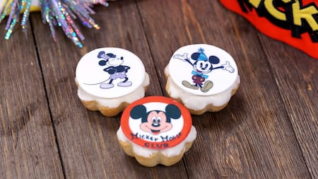 3 pastries, each representing a different era of Mickey Mouse's career