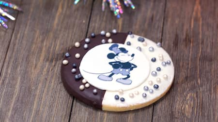 A large cookie, featuring an image of Mickey Mouse from Steamboat Willie
