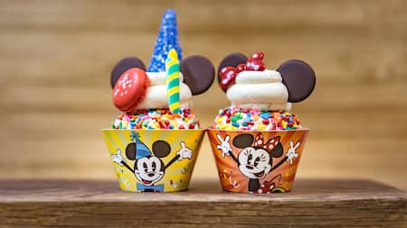 Mickey Mouse and Minnie Mouse themed desserts next to each other