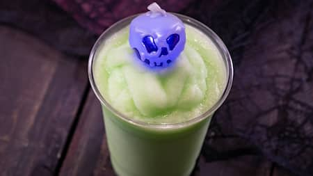 Purple skull souvenir in a green slushy drink