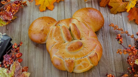 A loaf of bread in the shape of Mickey Mouse with fangs