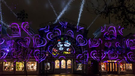 Hearts and an image of Mickey Mouse and Minnie Mouse, projected onto Crystal Arcade