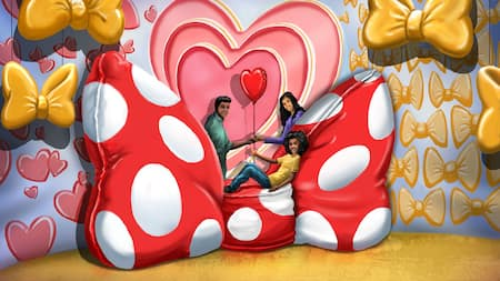 A family poses for pictures in a Minnie Mouse themed backdrop, featuring a giant version of her hair bow