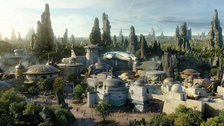 Villagers, visitors and droids from across the galaxy explore Black Spire Outpost on the planet Batuu