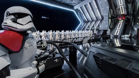 A large group of First Order Stormtroopers aboard a First Order Star Destroyer on the Star Wars Rise of the Resistance attraction at Disneyland park